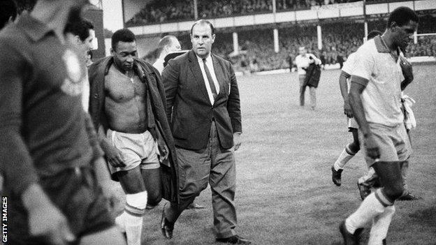 A dejected Pele leaves the field at Goodison Park after being beaten 3-1 by Portugal, 1966.